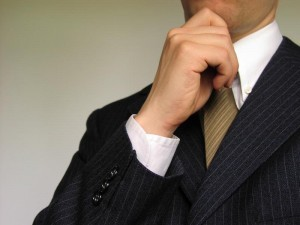 1722-business-man-holding-hand-to-chin-pv-300x225